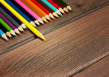 Multicolored pencils on a background of dark wood tables Stock Images