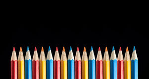 Multicolored Pencils on Black Background Royalty Free Stock Images