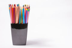 Multicolored pencils in the black box on a white background. Back to school concept. Royalty Free Stock Images