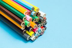 Multicolored pencils on a blue background, children`s creativity.  stock image