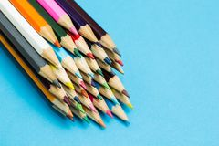 Multicolored pencils on a blue background, space for text.  royalty free stock images