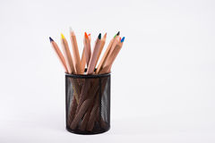 Multicolored pencils in the box on a white background. Back to school concept. Stock Photo