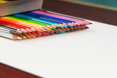 Multicolored pencils in the box on a wooden table. Back to school. Copy space Stock Photo