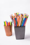 Multicolored pencils in the boxes on a white background. Back to school concept. Royalty Free Stock Images