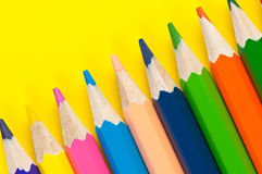 Multicolored pencils close up on yellow background Royalty Free Stock Image