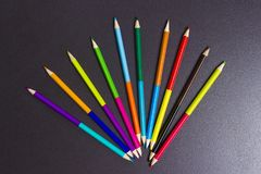 Multicolored pencils for drawing on a black background. Creative concept Stock Images