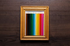 Multicolored pencils in a frame Royalty Free Stock Images