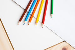 Multicolored pencils lying on a white table Royalty Free Stock Photography