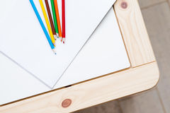 Multicolored pencils lying on a white table Stock Photo