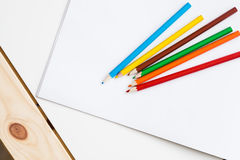 Multicolored pencils lying on a white table Royalty Free Stock Photo