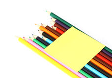 Multicolored pencils and note stick Stock Photos