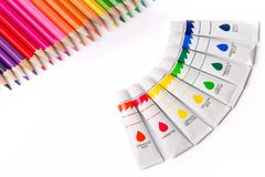 Multicolored pencils and paints for creativity. Multicolored pencils and paints in tubes for creativity Royalty Free Stock Photos