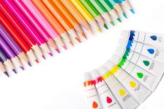 Multicolored pencils and paints for creativity. Multicolored pencils and paints in tubes for creativity Royalty Free Stock Images