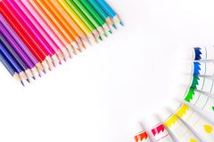 Multicolored pencils and paints for creativity. Multicolored pencils and paints in tubes for creativity Stock Photo