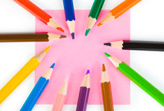 Multicolored pencils and paper Stock Images