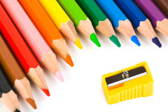 Multicolored pencils and sharpener Stock Images
