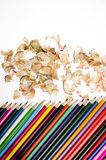 Multicolored pencils and shavings on white background Stock Photography