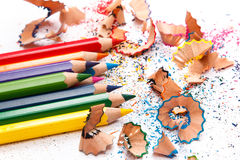 Multicolored pencils and shavings Royalty Free Stock Photos