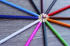 Multicolored pencils spread out in a circle royalty free stock image