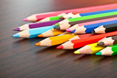 Multicolored pencils on the table Royalty Free Stock Images