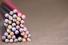 Multicolored pencils on the table. A stack of colored pencils ti Stock Photos