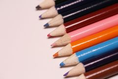 Multicolored pencils on the table. A stack of colored pencils ti Stock Photography