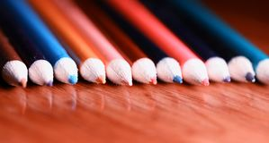 Multicolored pencils on the table. A stack of colored pencils ti Royalty Free Stock Photos