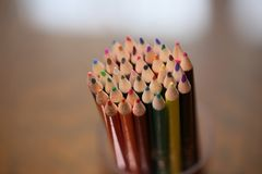 Multicolored pencils on the table. A stack of colored pencils ti Stock Photo