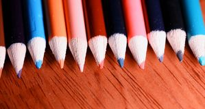 Multicolored pencils on the table. A stack of colored pencils ti Royalty Free Stock Image