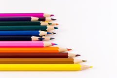 Multicolored Pencils on White Background Stock Photos
