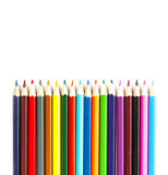 Multicolored pencils on white background to create a collage Stock Photo
