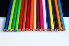 Multicolored pencils on a white and black background Stock Photography
