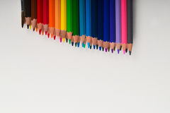Multicolored pencils on the white paper. Back to school. Copy space. Top view Stock Photo