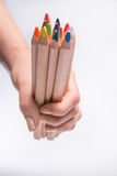 Multicolored pencils in the woman hand on a white background. Back to school concept. Royalty Free Stock Images