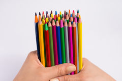 Multicolored pencils in the woman hands on a white background. Back to school concept. Royalty Free Stock Photos