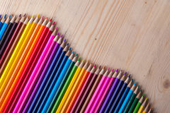 Multicolored pencils on wooden table, top view. Stock Image