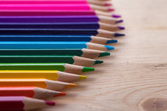 Multicolored pencils on wooden table, top view. Stock Photography