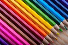 Multicolored pencils on wooden table, top view. Royalty Free Stock Images