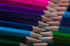 Multicolored pencils on wooden table, top view. Royalty Free Stock Photo