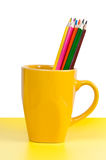 Multicolored pencils in yellow cup Royalty Free Stock Images