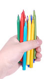 Multicolored pens in hand Stock Image