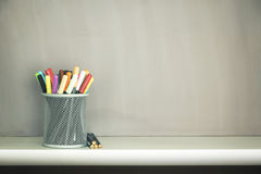 Multicolored pens  in jar on table with copy space. Stock Images
