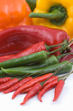 Multicolored peppers on white Stock Image