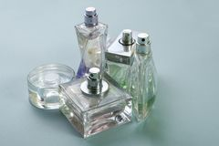 Multicolored perfumes in bottles of different shapes Royalty Free Stock Image