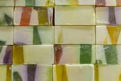 Multicolored pieces of handmade soap lie in rows. rough surface texture royalty free stock images