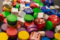 A multicolored pile consisting of dice and wooden chips. Close-up Royalty Free Stock Photos