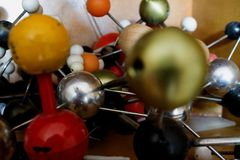 Multicolored pile of old models of molecular compounds royalty free stock images