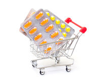 Multicolored pills packs in shopping cart Stock Photography