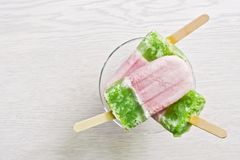 Free Multicolored Pink-green Ice Cream On A Stick. White Background, Top View, Copy Space. Stock Photography - 114431772