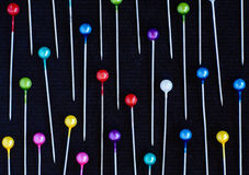 Multicolored pins background Stock Images